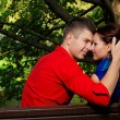 Portrait of couple posing in park — Stock Photo #13641791