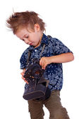 Portrait of handsome kid posing on white background with camera — Stock Photo