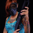 Tattooed girl with a shotgun — Stock Photo