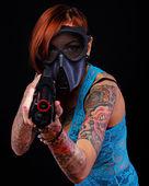 Cyberpunk girl with a shotgun — Stock Photo