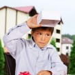 Portrait of handsome kid opened his gift on birthsday - Stock Photo