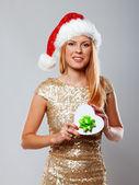 Portrait of beautiful girl posing in studio in christmas hat — Stock Photo