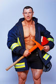 Portrait of handsome man posing on black background in fireman c — Stock Photo
