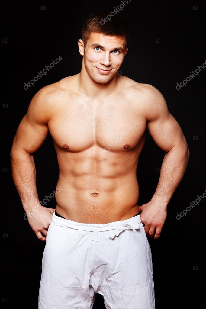 Portrait of muscle man posing in studio  Stock Photo #14336835