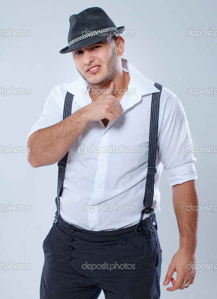 Portrait of sexy man posing in studio in hat — Stock Photo #15531447