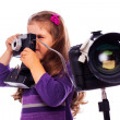 Stock Photo: Little girl is taking pictures