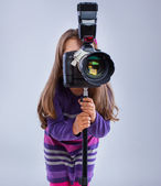 A small kid with a camera — Stock Photo