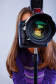 A cute sweet girl with a camera — Stock Photo