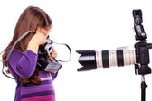 A little girl is taking pictures — Stock Photo