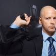 Man is posing on the floor with a gun — Stock Photo