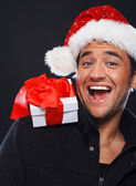 Portrait of handsome man posing on black background in christmas — Stock Photo