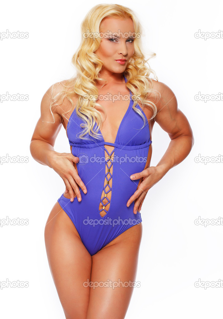 Sexy fitness blonde posing in studio over a white background — Stock Photo #20041731