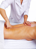 Skilled therapist making massage to her client — Stock Photo