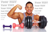 Attractive man posing in a studio with dumbbells — Stock Photo