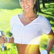 Beatufil sportswoman posing in the park. - Stock Photo