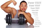 Confident guy posing in studio with big dumbbell — Stock Photo