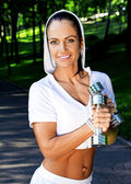 Fitness woman posing in the park — Stock Photo