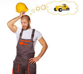 Bald man is thinking about tractor — Stock Photo