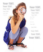 Girl is posing with a magnifier — Stock Photo