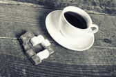 Photo of coffee cup and sugar heart — Stock Photo