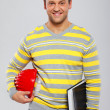 Happy businessman with helmet and folder on the white background — Stock Photo