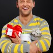 Birthday man is receiving his presents — Stock Photo