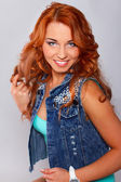 Attractive red haired woman is posing in studio — Stock Photo