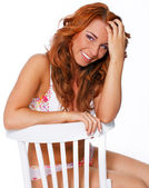Hot woman on the chair — Stock Photo