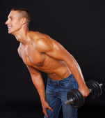 Weightlifter is posing while doing exercise — Stock Photo