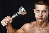 Portrait of man who is threaten with his trophey — Stock Photo