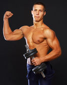 Bodybuilder is demonstrating his well trained hands — Stock Photo