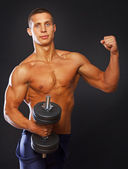 Athlete is demonstrating his well trained body — Stock Photo