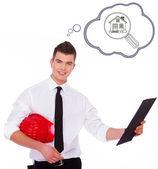 Geschäftsmann untersucht seinen arbeitsplan — Stockfoto