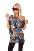 Shy blond woman is posing in tunic and sunglasses — Stock Photo