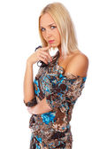 Serious blond woman in summer dress is posing on camera — Stock Photo