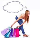 Woman have too heavy bags after shopping — Stock Photo