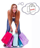 Woman is holding bags after shopping — Stock Photo