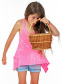 Little girl saw something in her basket — Stock Photo