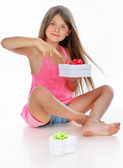 Little girl is demonstrating her presents — Stock Photo