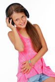 Attractive girl is holding headphone while listening music — Stock Photo