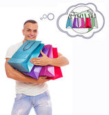 Man is holding bags and thinking about worldwide shopping — Stock Photo