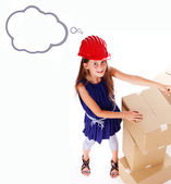 Nice girl in hardhat is playing with boxes — Stock Photo