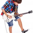 Teenage boy in headphones is playing on electro guitar — Stock Photo #22726813