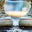 Zoomed white and high girlish gumshoes — Stock Photo #22726893