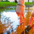 A pair of fingered is walking in the puddle - Stock Photo