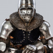Portrait of sitting armored knight - Stock Photo