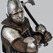 Knight who is threaten with his hatchet - Stockfoto