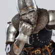 Stock Photo: Bored knight leon his fist