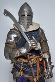 Portrait of man who is wearing a knights costume — Stock Photo