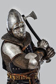 Knight who is threaten with his hatchet — Stock Photo